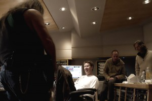 Me laying down Guitar Tracks while William H. Macy and others look on.